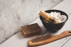 Wooden desktop with tools for shaving beards. Close up stock image