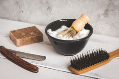 Wooden desktop with tools for shaving beards. Close up stock photos