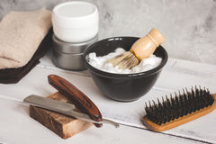 Wooden desktop with tools for shaving beards. Close up stock images