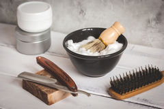 Wooden desktop with tools for shaving beards. Close up royalty free stock photos