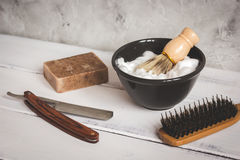Wooden desktop with tools for shaving beards. Close up stock photography