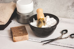 Wooden desktop with tools for shaving beards. Close up royalty free stock photo