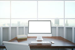 Wooden desktop with white computer Royalty Free Stock Photos