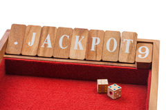 Wooden dice jackpot board game Stock Images