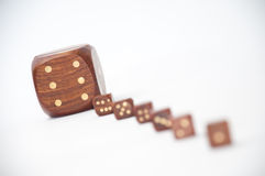 Wooden dices with one dice in focus Royalty Free Stock Images