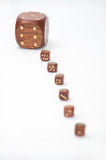 Wooden dices with one dice in focus Stock Images