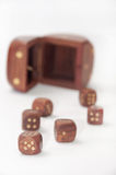 Wooden dices on the table Stock Photo