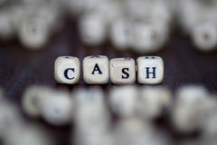 Wooden dices with the word CASH background Stock Photo