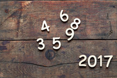 Wooden Digits Set. New year symbol. Set of wooden digits as 2017 on wood background Royalty Free Stock Photography