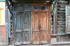 The wooden dilapidated doors. Old entrances in Irkutsk Royalty Free Stock Photo