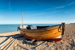 Wooden Dinghy on the Beach Stock Image