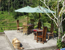 Wooden Dining Set. Next to a padi field in Ubud, Bali stock photos
