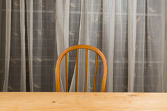 Wooden dining table and chair with nobody. Royalty Free Stock Image