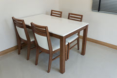 Wooden dining table royalty free stock photos