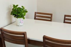 Wooden dining table Stock Images