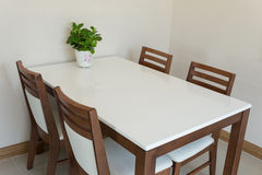 Wooden dining table royalty free stock photography