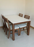 Wooden dining table Stock Image