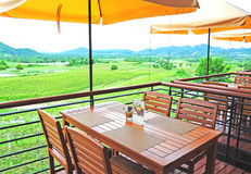 Wooden Dining Table of Restaurants. With  mountain view Royalty Free Stock Photo