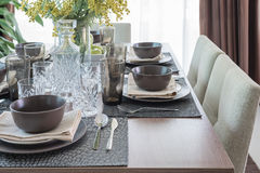 Wooden dining table with table set Stock Image