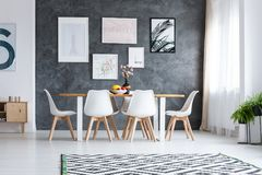 Wooden dining table under window stock photo