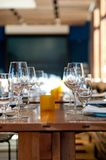 Wooden dining table and wine glasses Royalty Free Stock Images