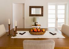 Wooden dining table. Royalty Free Stock Images