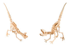 Wooden dinosaurs. Set of a wooden dinosaurs isolated on a white background Stock Photo