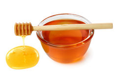 Wooden dipper with bowl of honey. Royalty Free Stock Photography