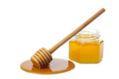 Wooden dipper with honey and bottle isolated Royalty Free Stock Image