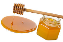 Wooden dipper with honey and bottle isolated Royalty Free Stock Photography