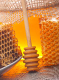Wooden dipper, honey and honeycomb Royalty Free Stock Image