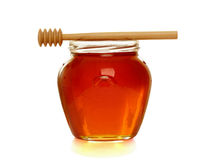 Wooden dipper with jar of honey. Stock Photography