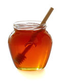 Wooden dipper with jar of honey. Royalty Free Stock Images