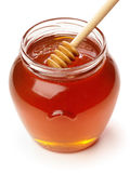 Wooden dipper with jar of honey. Royalty Free Stock Photo