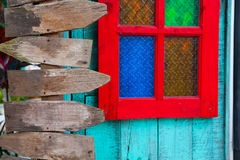 Wooden direct borders. Red windows with wooden direct borders royalty free stock images