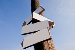 Wooden direction arrows on the Stock Photo