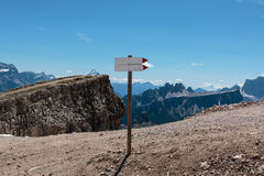 Wooden Direction Path Sign in Barren Rocky Mountain Royalty Free Stock Photography