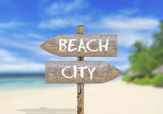 Wooden direction sign beach or city Royalty Free Stock Photos