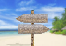 Wooden direction sign on beach Royalty Free Stock Photography