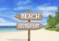 Wooden direction sign beach or restaurant Stock Photos