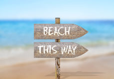 Wooden direction sign with beach this way Stock Photo