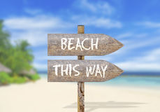 Wooden direction sign with beach this way Royalty Free Stock Photo