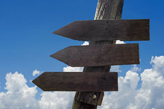 Wooden direction sign with blank spaces for text Royalty Free Stock Photo