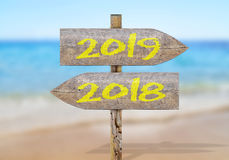 Wooden direction sign with 2019 and 2018. Close Stock Photography