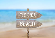 Wooden direction sign with florida beach Royalty Free Stock Photography