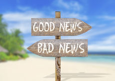 Wooden direction sign with good and bad news Stock Image