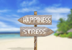 Wooden direction sign happiness or stress. Close Royalty Free Stock Photo