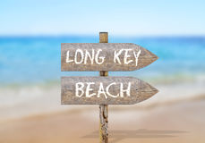 Wooden direction sign with Long Key beach Stock Image