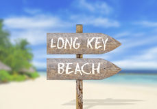 Wooden direction sign with Long Key beach Royalty Free Stock Images
