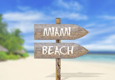 Wooden direction sign with Miami beach Royalty Free Stock Photo